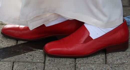 POPE'S RED SHOES SEEN AS HE ARRIVES IN SCOTLAND